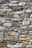 Stone wall background. Stone wall made of a lot of stones, big and small Royalty Free Stock Image