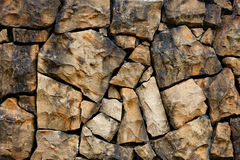 Stone wall. Background of the stone wall Stock Photo