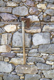 Stone wall background and axe Stock Photo
