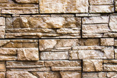 Stone wall background. Brown stone used for decoration Royalty Free Stock Photo