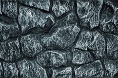 Stone wall background - building feature. Texture of thick and strong wall of rough stones of various shapes and sizes.  Stock Images