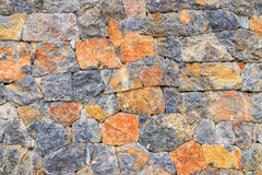Stone Wall Background, Close up Mixed Color of Stone Wall. Close up Irregularly Shapes of Real Stone Wall  (Background&#x29 Stock Photo