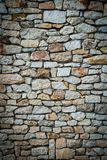 Stone wall background. Vignetted borders. Vertical photo Stock Image