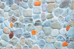 Stone wall background. The background is a gray stone wall stock images