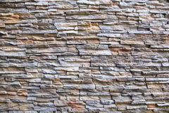 Stone wall background. Layered light-brown stone wall background Stock Images