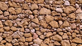 Stone wall background stock video footage