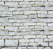 Stone wall background. Many stones stock photography