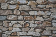 Stone wall background with matt film effect. Stone wall background of colorful stones with matt film effect stock images