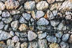 Stone wall Background and mesh wire stock image