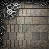 Stone wall background with metal gears Royalty Free Stock Photography