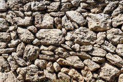 Stone wall background. Old stones. Stock Photos