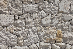 Stone wall background. Old stones. Stock Image