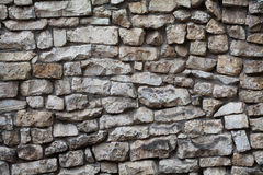 Stone wall background. Textured pattern facade building. macro view, soft focus Stock Photos