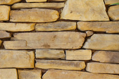 Stone wall Background. Tight set flagstone wall natural beige Royalty Free Stock Photos