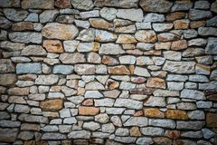 Stone wall background with vignetted borders. Stone wall background of colorful stones with vignetted borders Stock Photography