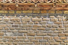 Stone wall background with wooden beams and tiles Royalty Free Stock Photography
