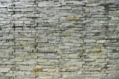 Stone wall backgrund. Texture of a stone wall royalty free stock image