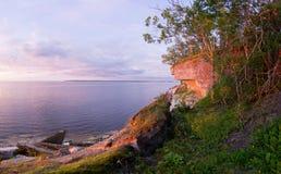 Stone wall on the Baltic sea in the summer. Pakri coast, island in Estonia, Europe.  Royalty Free Stock Image
