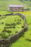 Stone wall and barn Royalty Free Stock Photos