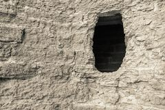 Stone wall of beige color with a hole Royalty Free Stock Photography