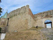Stone wall and gate of Belgrade fortress, church of the Holy Mother of God on left side Royalty Free Stock Images