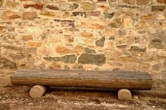 Stone wall and bench. Stone wall and wooden bench Royalty Free Stock Image