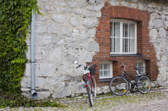 Stone wall and bicycles Royalty Free Stock Images
