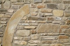 Stone wall with a big piece. Arched Royalty Free Stock Photo