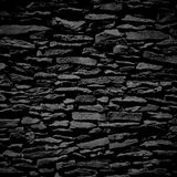 Stone wall, black relief texture with shadow Royalty Free Stock Photos