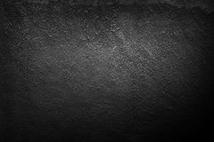 Stone wall. Black stone wall texture background Royalty Free Stock Image