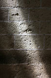 A stone wall, with a blade of light Stock Image