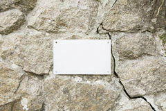 Stone wall with a blank Stock Images