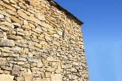 Stone wall with blue background. On a sunshine day Royalty Free Stock Photography