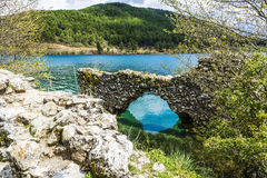 Stone Wall at Blue Lake in the mountains Stock Photos