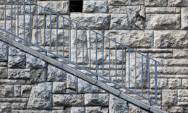 Stone wall with blue railings Stock Photos