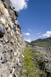 Stone Wall with Blue Sky and Clouds Royalty Free Stock Photography