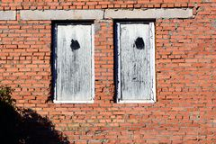 Stone wall and blue window shutter. Traditional house Royalty Free Stock Photography