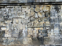 Stone wall at the Borobudur temple, Indonesia Stock Images