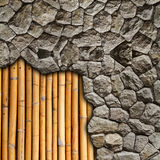 Stone wall break on wall bamboo background Stock Photography