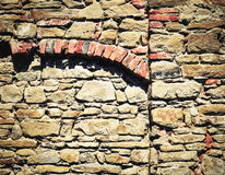 Stone wall with brick arch royalty free stock image