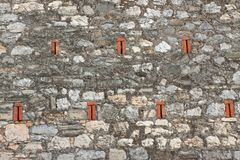 Stone wall with brick elements. stock photos