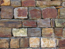 Stone wall brown an orange colour backround texture Stock Photo
