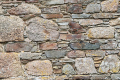 The stone wall builders art. Old stone wall in a village in Cornwall UK hand built in the 19th century, showing the skill of the masons of old Stock Image