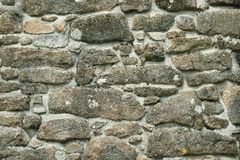 The stone wall builders art. Old stone wall in a village in Cornwall UK hand built in the 19th century, showing the skill of the masons of old Royalty Free Stock Photo
