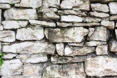 Stone Wall. A wall built of rough mountain wild stone white-washed white Royalty Free Stock Photo