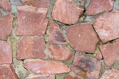 Stone wall bulge texture background natural color closeup selective focus.  stock photo