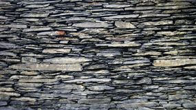 Stone wall of bygone years. The wall is a structural element in architecture and construction, creating an external perimeter of a building or room in the form royalty free stock photo