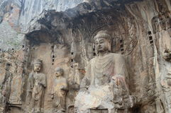 Stone Wall Carved Statues - Buddhist Longmen Caves Royalty Free Stock Photo