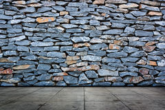 Stone wall and cement  flooring Royalty Free Stock Photo
