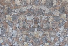 Stone wall with cement grout indoor or out colorful rocks and te stock image